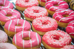 Sweet donuts arranged at display Royalty Free Stock Image