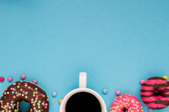 Sweet donuts with coffee on the blue background. Delicious donut Royalty Free Stock Images
