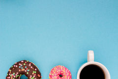 Sweet donuts with coffee on the blue background. Delicious donut Royalty Free Stock Photo