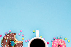 Sweet donuts with coffee on the blue background. Delicious donut Stock Image