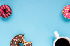 Sweet donuts with coffee on the blue background. Delicious donut Royalty Free Stock Photography
