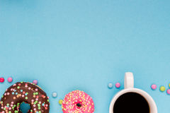 Sweet donuts with coffee on the blue background. Delicious donut Stock Photography