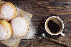 Sweet donuts and coffee cup on table Stock Photo