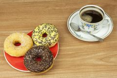 Sweet donuts with coffee. Sweet treat with coffee. Donuts as quick homemade treats. Junk food diets enemy. A symbol of junk food and obesity, donut for a snack stock photography