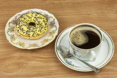 Sweet donuts with coffee. Sweet treat with coffee. Donuts as quick homemade treats. Junk food diets enemy. A symbol of junk food and obesity, donut for a snack stock photo