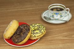 Sweet donuts with coffee. Sweet treat with coffee. Donuts as quick homemade treats. Junk food diets enemy. A symbol of junk food and obesity, donut for a snack stock image
