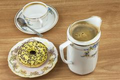Sweet donuts with coffee. Sweet treat with coffee. Donuts as quick homemade treats. Junk food diets enemy. A symbol of junk food and obesity, donut for a snack royalty free stock photography