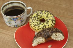 Sweet donuts with coffee. Sweet treat with coffee. Donuts as quick homemade treats. Junk food diets enemy. Stock Photo