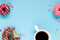 Sweet donuts with cup of coffee on the blue background. Delicious donut Royalty Free Stock Photography
