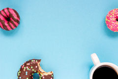 Sweet donuts with cup of coffee on the blue background. Delicious donut Royalty Free Stock Images
