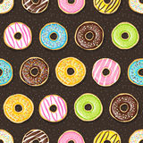 Sweet donuts on the dark background. Royalty Free Stock Photography