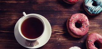 Sweet donuts on a dessert and a cup of tea Royalty Free Stock Photography