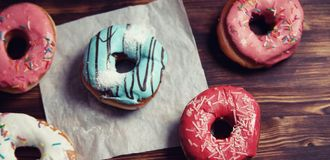 Sweet donuts on a dessert and a cup of tea Royalty Free Stock Photos