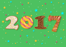 2017. Sweet donuts font. Happy New Year 2017. Calendar template. Colorful, hand drawn symbols. Sweet donuts font. Celebration background with confetti stars Royalty Free Stock Photos