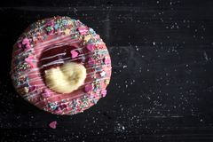 Sweet donuts with hearts. Heart shape donut with vanilla and jam on the dark background,selective focus and blank space Royalty Free Stock Image