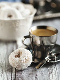 Sweet donuts with icing sugar and cup of coffee Stock Photo