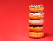 Sweet donuts on red Royalty Free Stock Photos