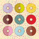 Sweet donuts set with icing and sprinkls isolated, pastel colors on beige polka dot background. Vector Royalty Free Stock Photography