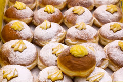 Sweet donuts. Various Warm and sweet donuts in a market bakery Stock Photo