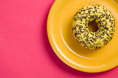 Sweet doughnut on plate Royalty Free Stock Image