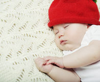 Sweet dream of baby in red hat Stock Photography