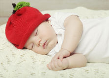 Sweet dream of baby in red hat Stock Photo