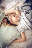 Sweet dream. Kid in bed. royalty free stock image