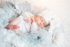 Sweet dream. newborn sleeping. White clothes. close up. the concept of childhood Royalty Free Stock Photography