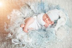 Sweet dream. newborn sleeping. White clothes. close up. the concept of childhood Royalty Free Stock Images