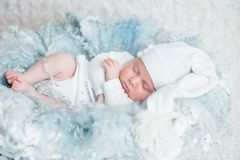 Sweet dream. newborn sleeping. White clothes. close up. the concept of childhood Stock Photo