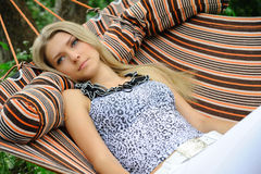 Sweet dreams. Girl dreams of in a hammock Royalty Free Stock Image