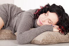 Sweet dreams. Beautiful girl in sweater is sleeping and having sweet dreams Stock Photography