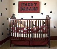Sweet Dreams. Beautiful wooden baby crib with sweet dreams sign Stock Image