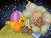 Sweet dreams baby. A little baby boy sleeping with his toys Stock Photography