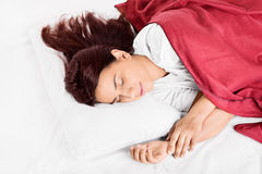 Sweet dreams. Beautiful girl sleeping, making an impression she's dreaming something nice Royalty Free Stock Photos