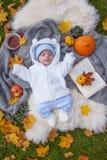 Little boy relaxing in autumn park stock photo