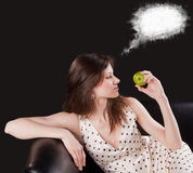 Sweet dreams of girl with apple Royalty Free Stock Photo