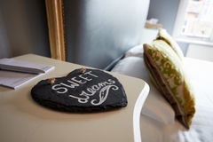 Sweet Dreams Printed On Slate Heart Next To Hotel Bedroom Royalty Free Stock Photos