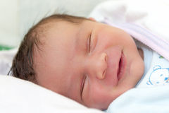 Sweet Dreams Smile. A Baby Boy with Smily Face During Sleep Royalty Free Stock Photo