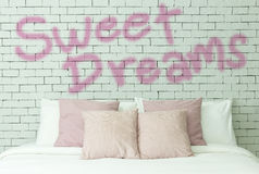 Sweet dreams word on white bricks wall background Royalty Free Stock Photo