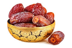 Sweet dried dates in oriental cup. Isolated on white Stock Photos