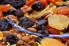 Sweet dried fruits. Arabic dessert - many dried sweet fruits and nuts on plate close up Stock Photo