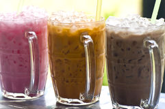 The sweet drink with iced. Three glasses of sweet drink Stock Images