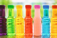 Sweet drinking colorful water bottles Royalty Free Stock Photos