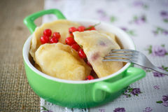 Sweet dumplings with cheese and berries Stock Photo