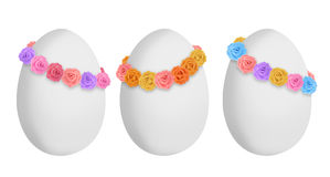Sweet easter eggs. Easter eggs with multicolor roses crowns Stock Photo