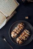 Sweet eclair dessert on black background Royalty Free Stock Photos