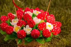 Sweet edible bouquet of sweets in the form of strawberries. Handmade. Gift for St. Valentine`s Day