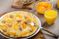 Sweet Egg omelet with walnuts and peaches Stock Photos