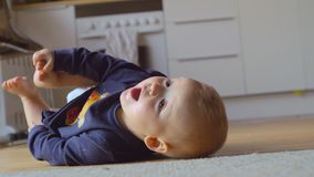 Baby girl rolling on the floor at home